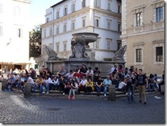 Trastevere area people sitting around fountain_small