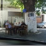 Armenoi men sitting around a tree in main square