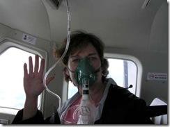 Joyce breathing via oxygen mask in plane-400