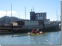 kayak-boat old tugboat