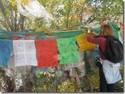 Joyce hanging our prayer flag