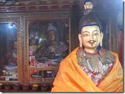 Pabonga Monastery statues with money
