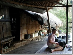 Joyce relaxes in tribe home