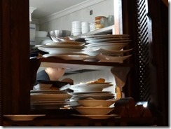 dirty plates stacked up in restaurant