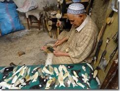 man making combs