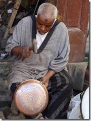 man making pots in Seffarine square 05