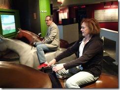 JOyce and David racing on horses