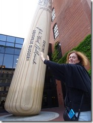 Joyce holding up baseball bat