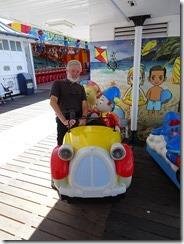 Tom and kiddie car