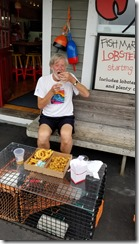 Tom eating clams at Clam Shack