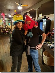 Joyce and Tom having fun with costume hats
