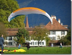 Interlaken paraglider landing in park