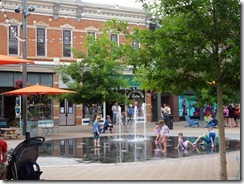 Children playing in a fountain on a hot day in Fort Collins